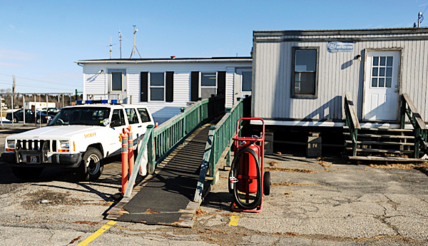 Plane passengers arriving at the Knox County Regional Airport are greeted by a wooden ramp which leads them to a double-wide trailer, which is the passenger terminal,  seen in this picture taken on Wednesday, Jan. 27, 2010, then to a parking lot, where the open air luggage claim is a wooden box next to the airport fence.  Airport officals will break ground for a new terminal on Friday, Jan. 29, 2010. BANGOR DAILY NEWS PHOTO BY KEVIN BENNETT
