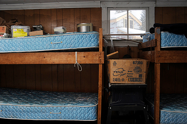 The soon to be razed camp house included two bunks to sleep four. Seen through the window is the the Dept. of Inland Fisheries and Wildlife's soon-to-be finished camp lodging on Baker Lake in located in T7 R17 WELS. D.I.F.W. Sgt. Chris Cloutier gave the BDN a tour of the lodging on December 28, 2009. BANGOR DAILY NEWS PHOTO BY JOHN CLARKE RUSS