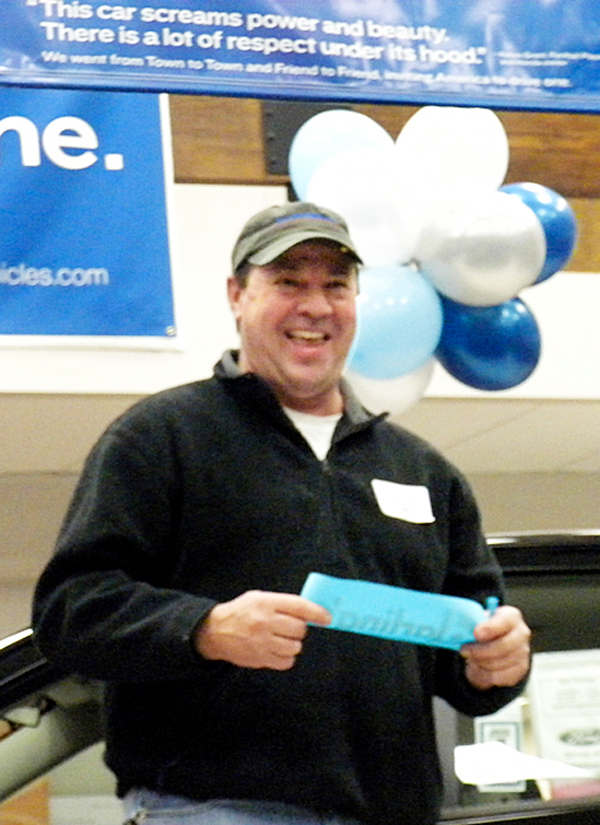 Daniel Kochis of Newburgh reacts to winning a brand new Ford Focus during Thursday night's United Way Campaign finale at Darlings Ford VW Audi dealership in Bangor. Kochis is a supervisor at Sargent Corp. in Old Town. BANGOR DAILY NEWS PHOTO BY DAWN GAGNON