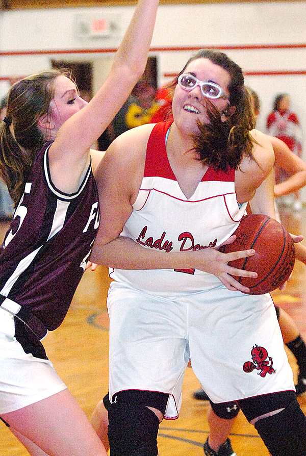 Central's Bekah Campbell (right) eyes the basket as Foxcroft Academy's Meghan Keane defends in the first half of Thursday's game, Jan. 28, 2010 at Central High School in Corinth. (Bangor Daily News/Bridget Brown)
