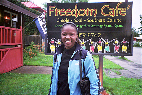 Pictures of seminarian Margarette Saintilver, during her visit to Maine last summer. The Freedom Cafe is in Waterville.   PHOTO BY ANN HOLLAND