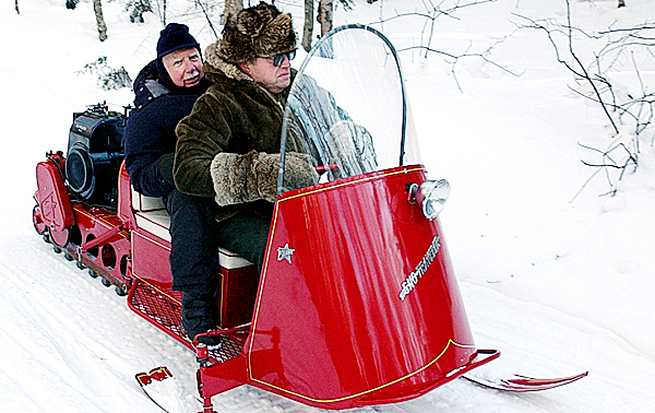 Retired Capt. Gerald Adler (left) of Davis, Calif., rides to and from the B-52 crash site Saturday at Elephant Mountain in Greenville (in 2003) on an antique Polaris snowmobile driven by Wayne Campbell of Millinocket, who was also one of the men who searched the moutain on the snowmobile as a 19-year-old college student the day the plane went down. BANGOR DAILY NEWS FILE PHOTO BY KEVIN BENNETT