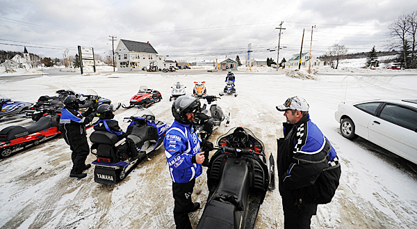 After filling up across the street at Coffin's General Store in Portage, ME to a group of Massachussetts snowmobilers get ready to depart after grabbing lunch at Dean's Motor Lodge and Restaurant Saturday afternoon, January 16, 2010. Snowmobiling BANGOR DAILY NEWS PHOTO BY JOHN CLARKE RUSS