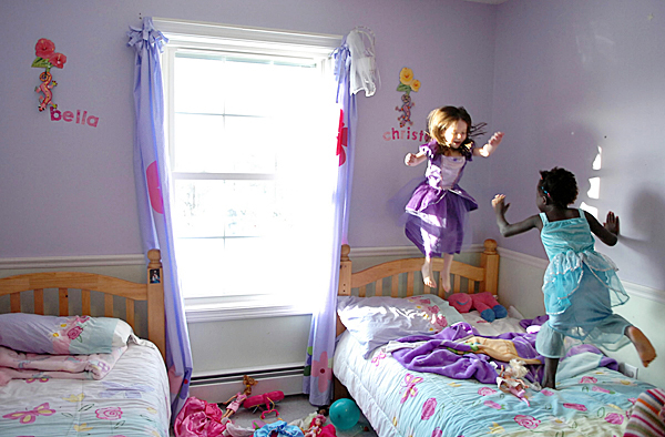 Sisters Bella, 4, (left) and Christella, 5, Logiodice play in their room Friday, Jan. 29, 2010 at their Pittsfield home. Their parents, Amanda and Jediah Logiodice, were united with their two adopted children from Haiti including Christella on Wednesday. Their mother recounted how after tucking the two girls into bed their first night,  she discovered in the morning that Bella had crawled into bed with her new sister. BANGOR DAILY NEWS PHOTO BY BRIDGET BROWN