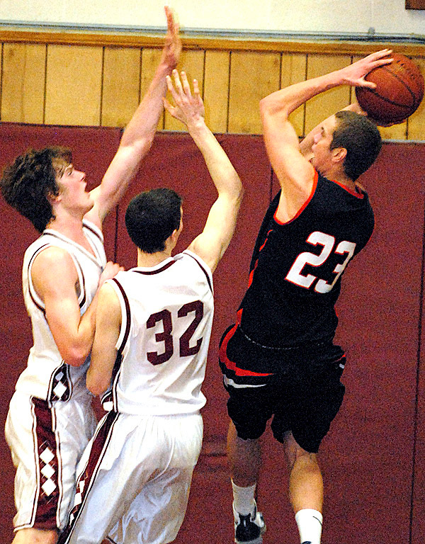 BANGOR, ME -- JANUARY 29, 2010 -- Bangor's Clark Noonan (left) and Zach Blodgett block a shot by Skowhegan's Nate Thistle in first half action of Friday night's game at Bangor.  BANGOR DAILY NEWS PHOTO BY LINDA COAN O'KRESIK