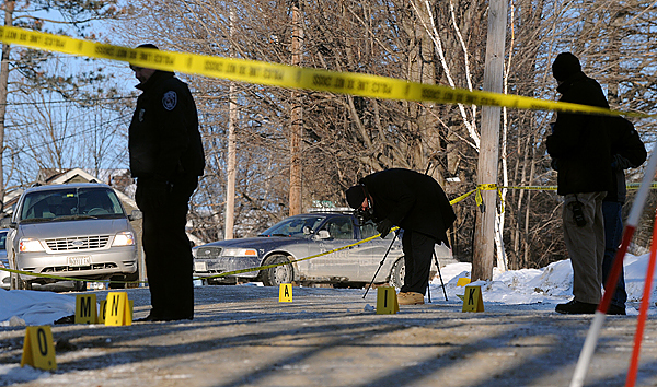 Orono Police and State Police investigate the scene where the body of a young woman was found on Middle Street in Orono Saturday morning. (Bangor Daily News/Gabor Degre)