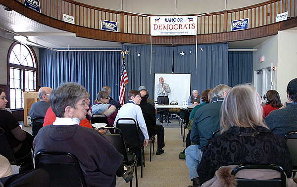 George Burgoyne (back center) leads the Bangor Democratic caucus at Wellman Commons on the former Bangor Theological Seminary campus on Sunday, Jan. 31, 2010. Democratic caucuses were held in 387 Maine towns Sunday during which they heard from candidates and chose delegates to the Democratic State Convention which will be May 21 and 22 in Lewiston. (Bangor Daily News/Bridget Brown)