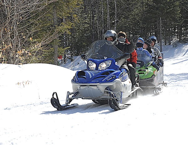 Members of the Fort Kent Sno-Riders Snowmobile Club provided ridesThursday for more than 50 people from three St. John Valley developmentally challenged  adult day program centers at the 10th Mountain Ski Lodge. (NEWS photo by Julia Bayly)