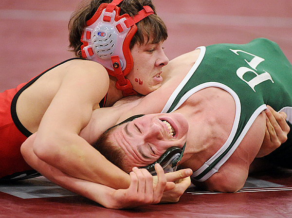 Dexter High School's Vincent Malinauskas (left) wrestles Penobscot Valley High School's David Sirois in the 112lbs weight class of the PVC Wrestling Championships  in Lincoln Saturday.  Malinauskas won the match. (Bangor Daily News/Gabor Degre)