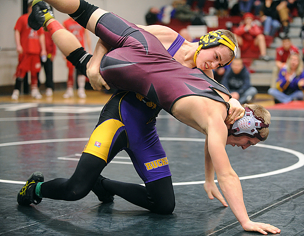 Bucksport High School's Jacob Stewart (top) wrestles Foxcroft Academy's Wesley Stinson in the  140lbs weight class of the PVC Wrestling Championships  in Lincoln Saturday.   Stewart won the match. (Bangor Daily News/Gabor Degre)