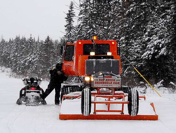 Groomers are out taking care of more than 13,500 miles of snowmobile trails in Maine regardless of weather. The best time for these trail tenders is late evenings when there is less traffic and colder temperatures allow the trails to harden. (NEWS Photo by Julia Bayly)