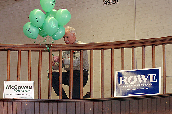 Jim Davitt puts up balloons in support of gubernatorial candidate Elizabeth &quotLibby&quot Mitchell during the Bangor Democratic caucus at Wellman Commons on the former Bangor Theological Seminary campus on Sunday, Jan. 31, 2010. Democratic caucuses were held in 387 Maine towns Sunday during which they heard from candidates and chose delegates to the Democratic State Convention which will be May 21 and 22 in Lewiston. (Bangor Daily News/Bridget Brown)