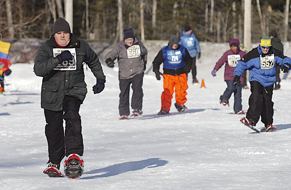 Charles Tozier of Bangor (left) leaves his competition in the dust during the 100 meter race at the Special Olympics Maine Winter Games at Sugarloaf in Carrabasset Valley on Monday, Feb. 1, 2010. Olympians also competed in skating and skiing races at the 41st annual event. BANGOR DAILY NEWS PHOTO BY BRIDGET BROWN
