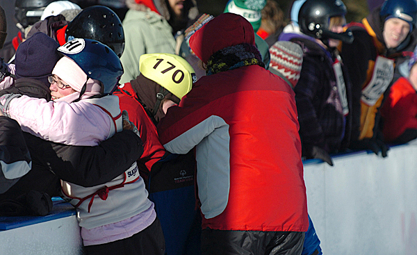 Molly Berry of Orono (left) gets a hug following her skating race at the Special Olympics Maine Winter Games at Sugarloaf in Carrabasset Valley on Monday, Feb. 1, 2010. Olympians also competed in snowshoeing and skiing races at the 41st annual event. BANGOR DAILY NEWS PHOTO BY BRIDGET BROWN