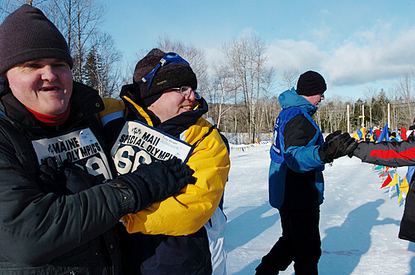 Charles Tozier of Bangor (left), embraces Tony Skidgel after edging out a victory over Skidgel in the 50 meter snowshoe race at the Special Olympics Maine Winter Games at Sugarloaf in Carrabasset Valley on Monday, Feb. 1, 2010. Olympians also competed in skating and skiing races at the 41st annual event. BANGOR DAILY NEWS PHOTO BY BRIDGET BROWN