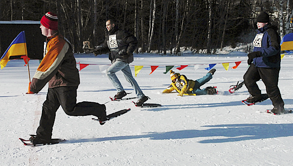 A snowshoe competitor loses a snowshoe and falls during the 100 meter race at the Special Olympics Maine Winter Games at Sugarloaf in Carrabasset Valley on Monday, Feb. 1, 2010. Olympians also competed in skating and skiing races at the 41st annual event. BANGOR DAILY NEWS PHOTO BY BRIDGET BROWN