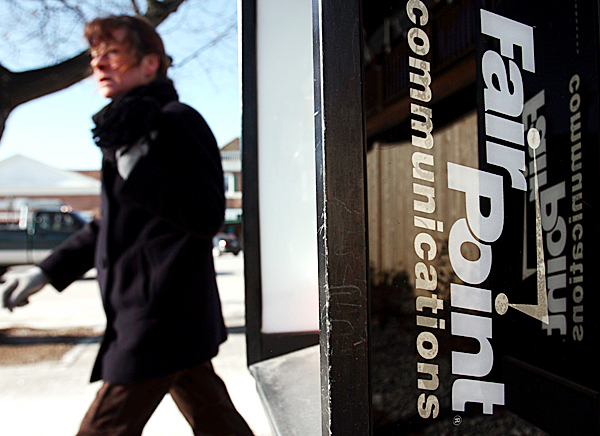 A pedestrian passes a  FairPoint company phone booth, in Brunswick, Maine, on Monday, Feb. 1, 2010. FairPoint Communications is pushing back the date for when it will submit its bankruptcy reorganizations plan.(AP Photo/Pat Wellenbach)