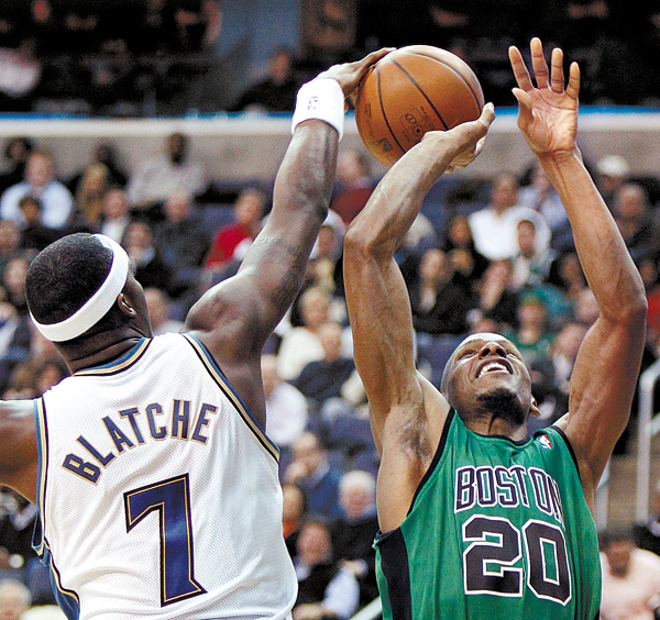 Washington Wizards forward Andray Blatche blocks a shot by Boston Celtics guard Ray Allen in the first half of an NBA basketball game in Washington Monday, Feb. 1, 2010.(AP Photo/Alex Brandon)