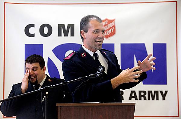 Capt. Josh Lyle, left, of the Salvation Army of Bangor reacts to a funny anecdote told by Capt. Brett DeMichael (foreground) of the Salvation Army Northern New England division office in Portland during the annual Volunteer Brunch at the Salvation Army of Bangor Wednesday, February 3, 2010. The Bangor Salvation Army handed out volunteer awards and recapped their achievements over the past year. They hope to raise $20,000 to send 125 youths to Camp Sebago this summer where Capt. DeMichael is camp director. (Bangor Daily News/John Clarke Russ)