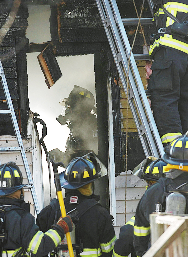 Bangor firefighters work at extinguishing a fire in a back extension of a house at 92 Second Street in Bangor on Thursday afternoon, Feb. 4, 2010. A dog was rescued from the second floor. No one was injured during the blaze. BANGOR DAILY NEWS PHOTO BY KEVIN BENNETT