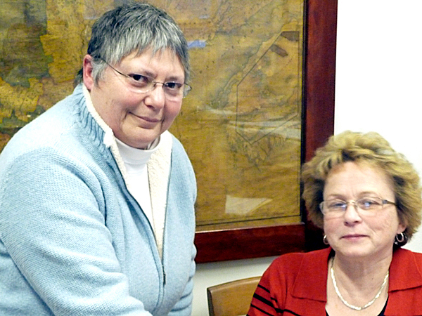 Betsy Fitzgerald, left, accepted the position of Washington County manager Thursday and was formally appointed by the county commissioners to replace Linda Pagels Wentworth, right, who resigned recently to accept the manager's position in Baileyville. &quotWe found what we wanted right here,'' Commission Chairman Chris Gardner said. Details of Fitzgerald's contract have not been determined and there will be a short transition period so that Machias can advertise and hire a new manager.   BANGOR DAILY NEWS PHOTO BY SHARON KILEY MACK