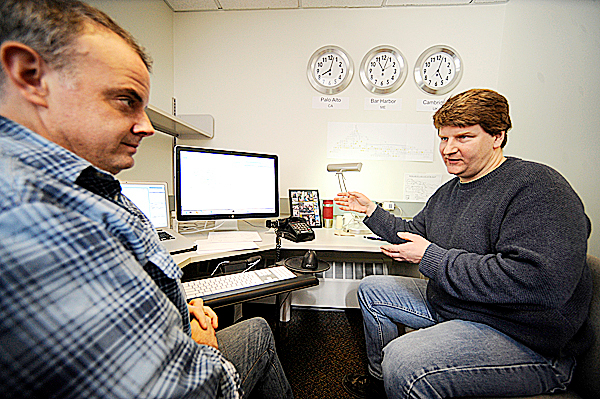 Terry Meehan, left, a scientific curator  and Alexander Diehl, right, a research scientist, consult each other while working on a universally recognizable computer biological classification system in Unit 5 at Jackson Laboratory in Bar Harbor, Maine on February 2, 2010. The recent influx of federal stimulus money to the lab is wholly supporting Meehan's job and paying for half of Diehl's salary.   BANGOR DAILY NEWS PHOTO BY JOHN CLARKE RUSS