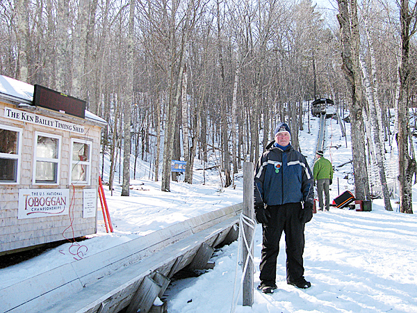 CAMDEN -- Chute Master Stuart Young stands next to the 400-foot-long wooden chute that plays an integral role in this weekend's 20th annual U.S. National Toboggan Championships. More than 400 teams will compete for bragging rights. &quotIt's a fun ride,&quot he said Thursday.   BANGOR DAILY NEWS PHOTO BY ABIGAIL CURTIS