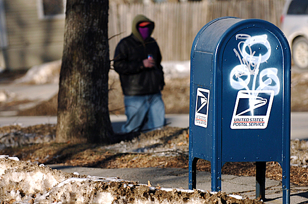 Overlapping graffitti tags are seen on a Center Street mailbox in Bangor on Friday, Feb. 5, 2010. BANGOR DAILY NEWS PHOTO BY BRIDGET BROWN