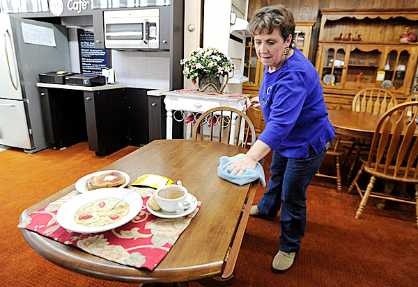 Joan Chasse of Frenchville, a part-time employee at Daigle Furniture and Appliance in dowtown Madawaska, wipes down furniture in the showroom Friday morning, February 5, 2010. &quotMy father worked there and my brother works there,&quot said Chasse of Fraser Papers impact on her family. &quotLet's just hope this [the contract vote] goes OK. We can't afford to lose this mill.&quot  BANGOR DAILY NEWS PHOTO BY JOHN CLARKE RUSS