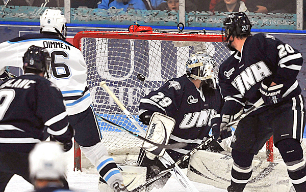 Maine's Jeff Dimmen, (6), watches his shot go under the crossbar over UNH goalie Brian Foster, (29), in the last minute of the second period of their NCAA hockey game in Orono, Maine, Friday, Feb. 5, 2010.  BANGOR DAILY NEWS PHOTO BY MICHAEL C. YORK