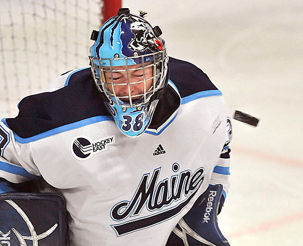 Maine goalie Scott Darling, (38), reacts as he gets a puck in the chest pad in the second period of their NCAA game inOrono, Maine, Friday, Feb. , 2010.