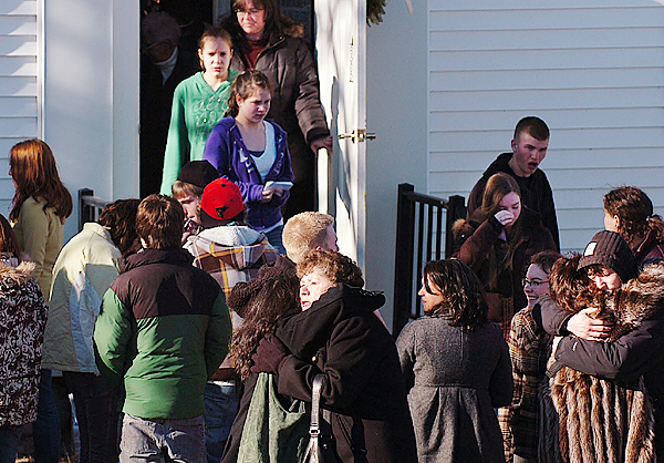 Friends and family of John &quotBobby&quot Surles embrace as they exit the Veazie Congregational Church on Saturday, Feb. 6, 2010 following Surles' funeral. Close to 300 community and family members attended the 19-year-old's funeral, who died of a gunshot wound during an altercation on Cumberland Street in Bangor last month. BANGOR DAILY NEWS PHOTO BY BRIDGET BROWN