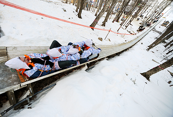 Members of the Royal Dutch National Tobbagan team from Holland compete in the 20th annual National Toboggan Championships at the Camden Snow Bowl on Saturday, Feb.6, 2010. The 400-foot ice covered chute provides thrills with teams hitting top speeds of 40 mph. BANGOR DAILY NEWS PHOTO BY KEVIN BENNETT