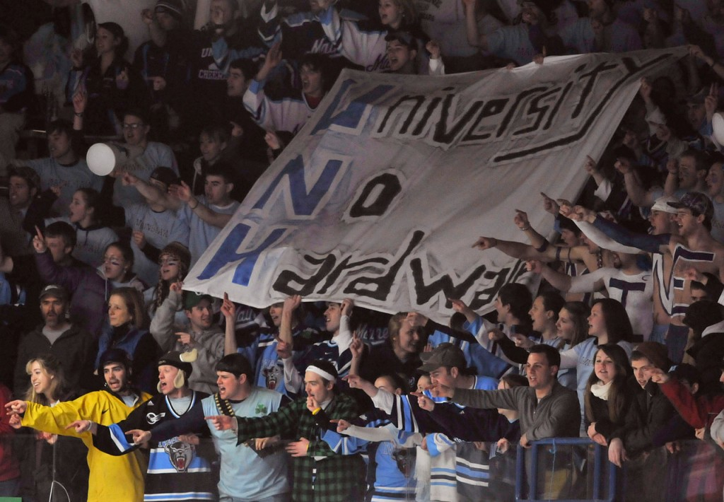 UMaine students taunt the UNH goalie in the first period of their NCAA hockey game in Orono on Friday. Buy Photo