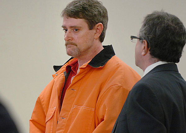 Perley Goodrich Jr., 45, (left) with the aid of his defense attorney Jeffrey Silverstein (right), entered pleas of not guilty and not criminally responsible by reason of insanity at his arraignment for the shooting death of his father Perley Goodrich Sr., on Monday, Feb. 8, 2010 at the Penobscot Judicial Center in Bangor. BANGOR DAILY NEWS PHOTO BY BRIDGET BROWN