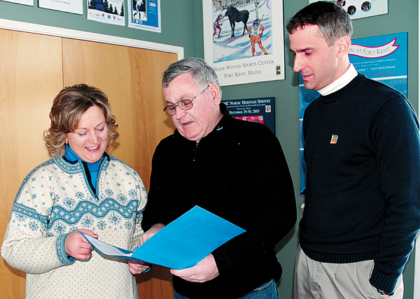 Eight Aroostook County residents are heading off to Vancouver to volunteer at the biathlon venue during the 2010 Winter Olympic Games. Going over some last minute travel details are three of the eight Nancy Thibodeau, Paul Grant (center) and Jeff Dubis all of Fort Kent. (BANGOR DAILY NEWS photo by Julia Bayly)
