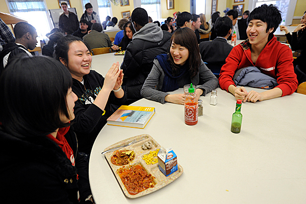 Senior Jiwon Yu (left), senior Yoon Ji Kang (second from left), campus intern Hyungi Shi and senior Ahn Jae Chang (right)-- all from South Korea-- catch up during lunch at Lee Academy Tuesday afternoon, February 9, 2010. A delegation of South Korean educators are visiting Lee Academy this week to help certify an academy satellite school slated to open in Daegu, South Korean in September 2010. BANGOR DAILY NEWS PHOTO BY JOHN CLARKE RUSS