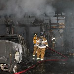 Man charged after truck, garage catch fire
