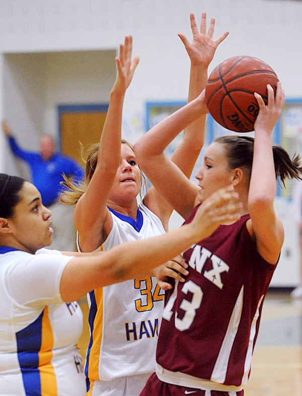 Mattanawcook Academy's Abby Paul (right) tries to pass the ball over Hermon High School's Carmen Nickerson (left) and Victoria Davenport during the first half of the game inHermon Tuesday evening. BANGOR DAILY NEWS PHOTO BY GABOR DEGRE