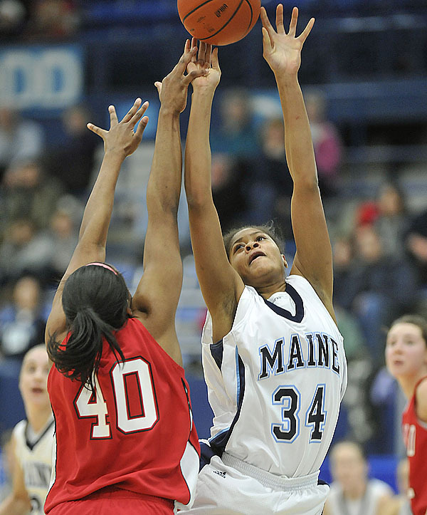 Hartford's Diana Delva, (40), can't get a hand on a shot by Maine's Corine Wellington, (34), in the second half of their game in Orono, Maine, Tues., Feb. 9, 2010.