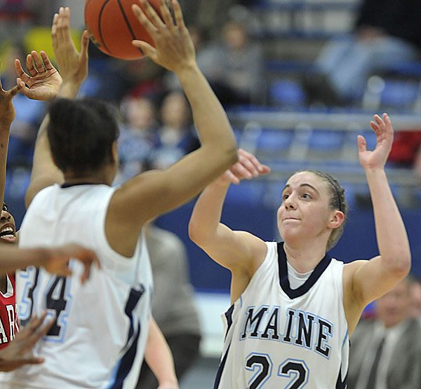 Maine's Samantha Wheeler, (22), and looks for a handle on loose ball in the second half of their game versus Hartford, in Orono, Maine, Tuesday, Feb. 9, 2010.