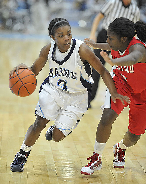 Maine's Brittany Williams, (3), looks to get the step on Hartford's Daphne Elliott, (2), in the second half of their game in Orono, Maine, Tues., Feb. 9, 2010.