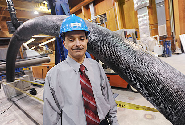 Professor Habib Dagher with a concrete-filled bridge arch.  BANGOR DAILY NEWS FILE PHOTO BY KEVIN BENNETT