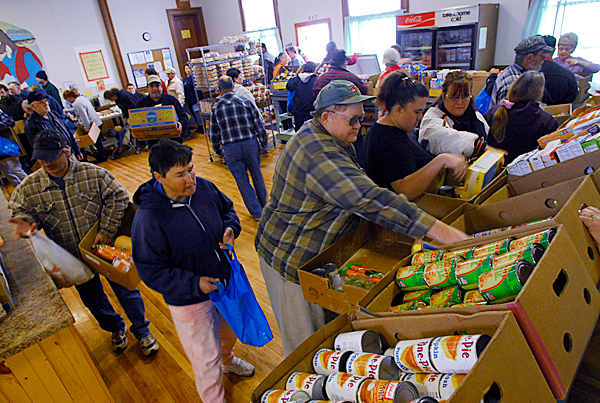 Families from Corinth and nearby towns pick up food items at the  Safe Place Community Center Food Cupboard building in Corinth on Thursday.  BANGOR DAILY NEWS FILE PHOTO BY JOHN CLARKE RUSS