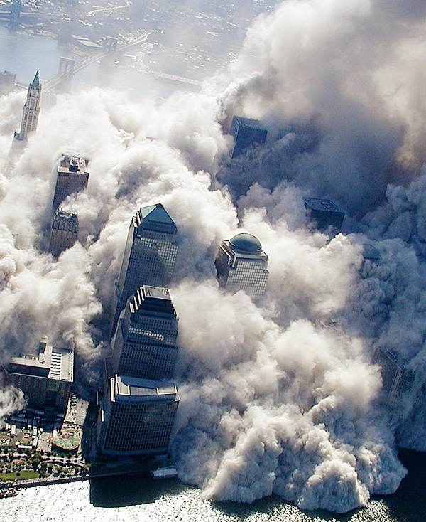 In this Sept. 11, 2001 photo made by the New York City Police Department and provided by ABC News, Tuesday Feb. 9, 2010 smoke and ash rise above downtown high-rise buildings and engulf lower Manhattan after terrorists flew two airliners into the World Trade Center towers. AP Photo/NYPD, via ABC News, Det. Greg Semendinger ) MANDATORY CREDIT
