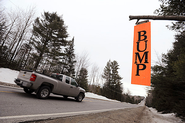 A bump sign hangs along Route 15 in the town of Monson on Wednesday, Feb. 10, 2010. BANGOR DAILY NEWS PHOTO BY KEVIN BENNETT