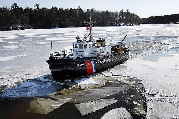 The U.S. Coast Guard cutter Bridle breaks ice in the Kennebec River, Friday, Jan. 29, 2010, in Richmond, Maine. The Coast Guard is breaking ice to help lessen the chances of winter flooding. An ice jam roughly a mile long and 10 to 15 feet high remains in place downstream from Hallowell.(AP Photo/Robert F. Bukaty)