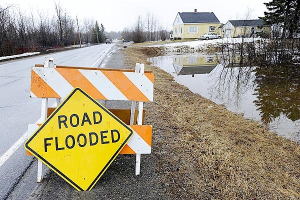 CAPTION  A sign discourages motorists from traveling any further on a stretch of the Washburn Road in Crouseville that was flooded Tuesday morning. This section of the the road was among several stretches in Aroostook County that fell victim to the spring thaw.   BANGOR DAILY NEWS PHOTO BY JOHN CLARKE RUSS  (WEB EDITION PHOTO)