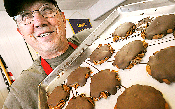 Lubec lobsterman Eugene Greenlaw with a tray full of chocolate sea turtles at his shop Bayside Chocolates in Lubec.  Greenlaw, 61, has been a chocolatier for nine years as a side business to being a commercial fisherman.  &quotPretty much any piece [of chocolate] you buy, I made it by hand and it does not sit around for months. I make it as the orders come in,&quot he said.  BANGOR DAILY NEWS PHOTO BY GABOR DEGRE
