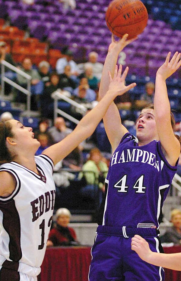Hampden's Julia Snyder (44) goes up for a shot against Edward Little's Miranda Martin in the first half of Friday's quarterfinal Class A game at the Augusta Civic Center on Feb. 12, 2010. Hampden won 48-35 BANGOR DAILY NEWS PHOTO BY BRIDGET BROWN